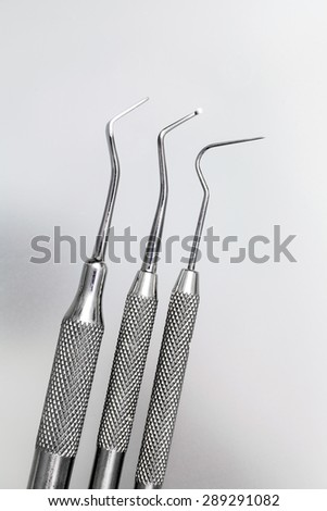 dentist's instruments with shallow depth of field blue tinted - stock photo