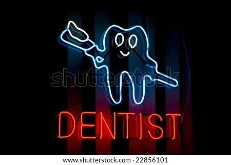 Dentist's neon sign in the window of a Harlem, New York City dental office - stock photo