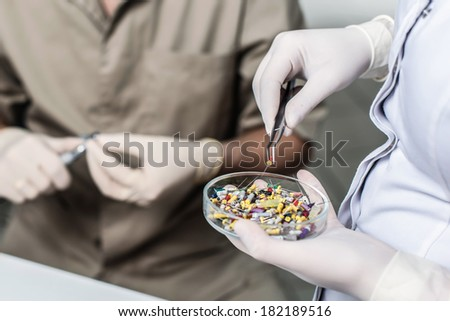 Dentist selecting his items. Dentist equipment. Stomatologist tools - stock photo