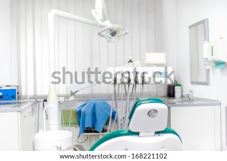 Dentist tools and dental equipment, dentist chair - stock photo
