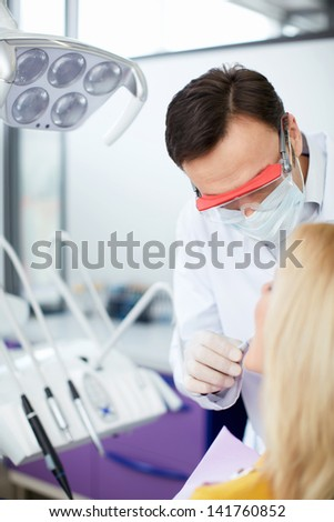Dentist with patient in office