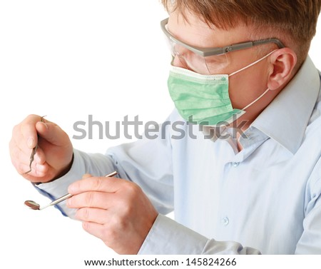 Dentist with tools, isolated on white background - stock photo