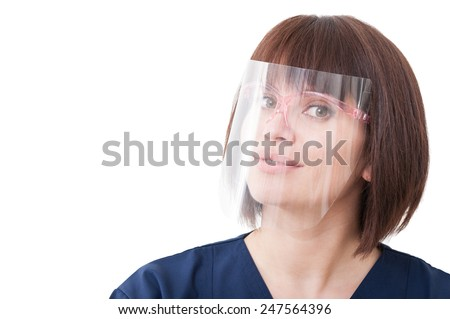 Dentist woman wearing big protection medical screen or plastic shield on her face - stock photo