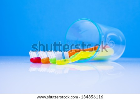 dentistry conceot with colorful toothbrushes - stock photo