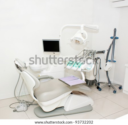 Dentistry office design view with tools and patient chair - stock photo