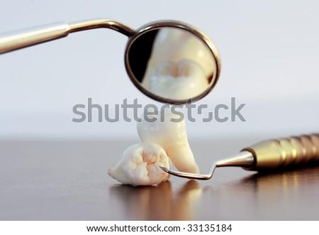 Dentistry. Wisdom teeth and dental tools - stock photo