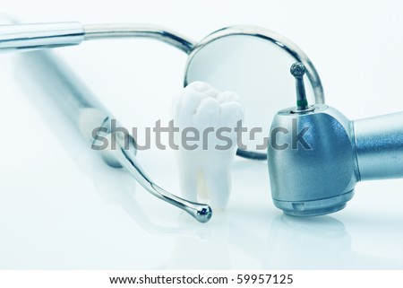 Dentistry. Wisdom tooth and dental tools - stock photo