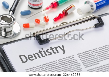 Dentistry written on a clipboard - stock photo