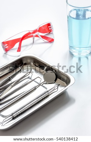 dentists tools in cabinet on white desktop