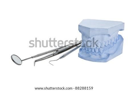 Denture cast model and dental tools set - stock photo