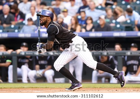 DENVER-AUG 21: Colorado Rockies infielder Jose Reyes swings at a pitch during a game against the New York Mets at Coors Field on August 21, 2015 in Denver, Colorado. - stock photo