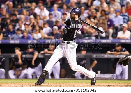 DENVER-AUG 21: Colorado Rockies outfielder Charlie Blackmon swings at a pitch during a game against the New York Mets at Coors Field on August 21, 2015 in Denver, Colorado. - stock photo