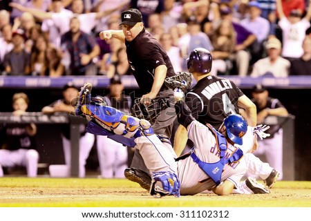 DENVER-AUG 21: New York Mets catcher Travis d'Arnaud tags out Colorado Rockies catcher Nick Hundley during a game at Coors Field on August 21, 2015 in Denver, Colorado. - stock photo