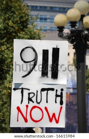 """DENVER – AUGUST 26: A conspiracy theory supporter (not shown) from """"9-11 Truth Now"""" holds a sign at a demonstration during the Democratic Convention on August 26, 2008 in Denver, Colorado. - stock photo"""