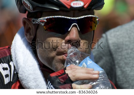 DENVER, CO - AUG 28: Australian pro cyclist Cadel Evans drinking water after the race finished at the 2011 USA Pro Cycling Challenge in Denver, Colorado on Aug 28, 2011 - stock photo