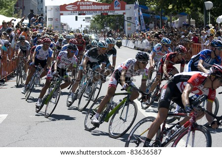 DENVER, CO - AUG 28: Professional cyclists maneuvering through a tight turn at the 2011 USA Pro Cycling Challenge in Denver, Colorado on Aug 28, 2011 - stock photo