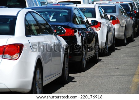 DENVER, CO, USA - JUNE 10, 2013: Cars in a parking lot at Denver airport. In 2013, Denver was the 5th busiest airport in the US and the 15th in the world with more than 52 million passengers.