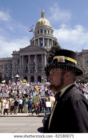 DENVER, COLORADO – APRIL 15: A man dressed as Abraham Lincoln stands in front of the state capital at the Tea Party Patriots Tax Day Rally in Downtown Denver, April 15, 2011