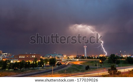 Denver, Colorado - Lightning strike in downtown Denver during a strong spring thunderstorm - stock photo