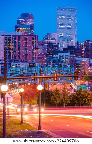 Denver Colorado Rush. Busy Denver Streets, Speer Boulevard Platte River Bridge and the City Skyline. October Night in Denver. - stock photo