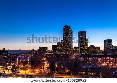 Denver Colorado skyline at dusk during the blue hour with lighted buildings and streets - stock photo