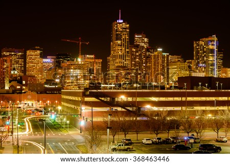 Denver, Colorado, USA - December 09, 2015: A night view of glittering skyscrapers and bright streets of Downtown Denver, near Metropolitan State University of Denver. - stock photo