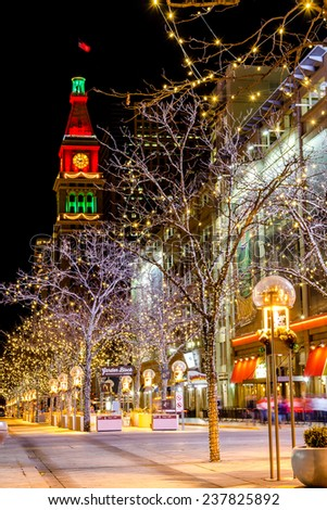 DENVER COLORADO USA - December 7, 2014: Holiday light display along Denver's 16th Street Mall with historic landmark Daniel Fisher Tower with red and green lights on December 7, 2014 in Denver CO
