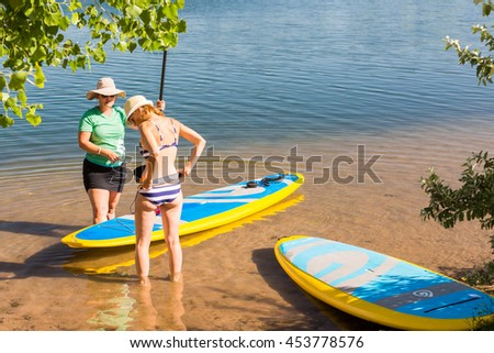 Denver, Colorado, USA-July 13, 2016. Paddleboarding Instructor giving lessons to first timers.