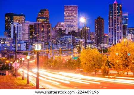 Denver Evening Traffic - Denver Commute After Dark. City in Motion. Denver Mile-High City. United States. - stock photo