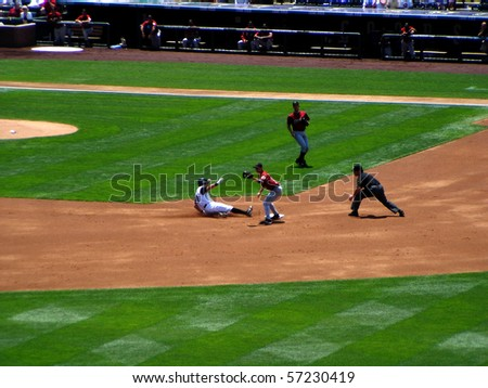 DENVER - JUNE 29: Aaron Miles of the Colorado Rockies slides safely into second base in a game at Coors Field against the Houston Astros June 29, 2005 in Denver, Colorado - stock photo