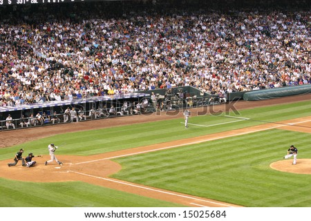 DENVER - JUNE 19: Derek Jeter, New York Yankees shortstop, at bat during the game with the Colorado Rockies at Coors Field, June 19, 2007 in Denver, Colorado. - stock photo
