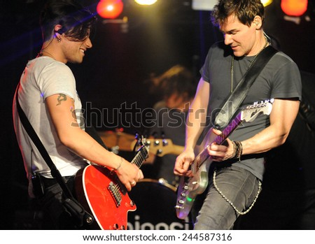 DENVERJUNE 26:Vocalist/Guitarist Don Miggs and Guitarist John Luzzi of the Rock band Miggs perform in concert June 26, 2014 at the venue Ecks in Denver, CO. - stock photo