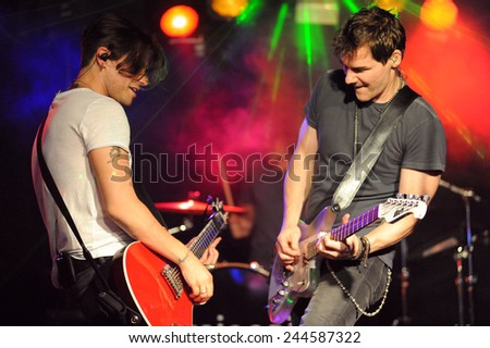 DENVER	JUNE 26:		Vocalist/Guitarist Don Miggs and Guitarist John Luzzi of the Rock band Miggs perform in concert June 26, 2014 at the venue Ecks in Denver, CO. - stock photo