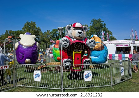 DENVER, PA, USA-SEPTEMBER 12, 2014:  Carnivals and country fairs are in full swing. They are common in late summer and early fall and include exhibits, food, rides, and entertainment for all ages.