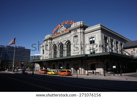 DENVER - SEPTEMBER 30: A line of taxicabs at Union Station on September 30, 2009 in Denver, Colorado. Opened in 1894, the vintage station has 4 Amtrak and 2 Light Rail tracks. - stock photo
