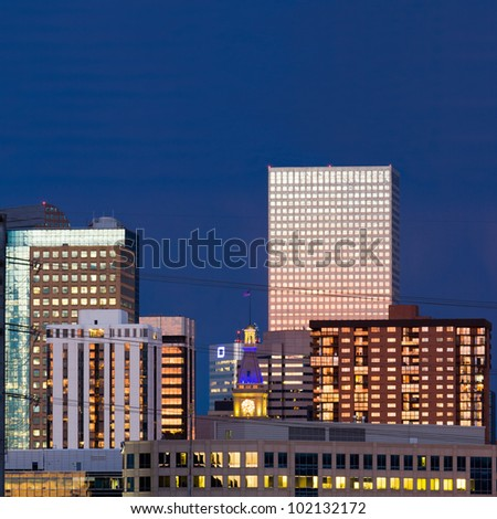 Denver skyline at dusk closeup with colorful sunset reflection in the windows - stock photo