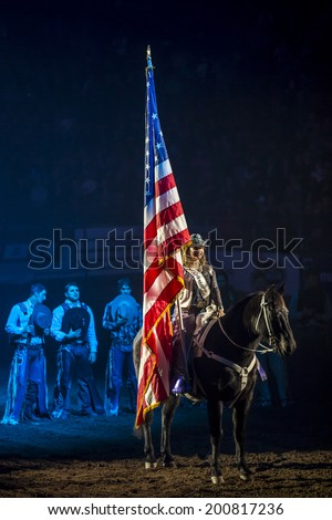 Denver, USA - January 14: Unidentified person taking part in a rodeo show in Denver, Colorado, on January 14, 2014. - stock photo