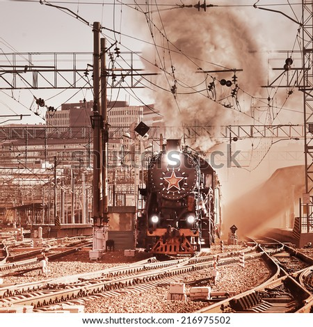 Departure of the retro steam train. Vintage image.