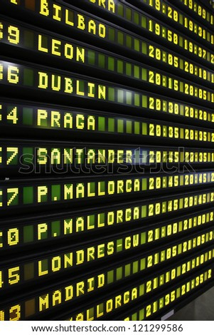 Departure schedule at an airport in Spain. Flights to Bilbao, Leon, Dublin, Prague, Santander, Mallorca, London and Madrid. - stock photo