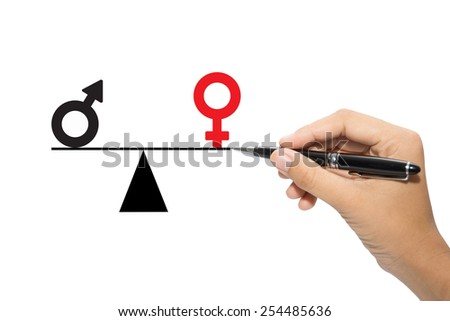 Depicted in a conceptual image by a man drawing a seesaw showing the male and female genetic symbols in equilibrium. Equality between the sexes.  - stock photo