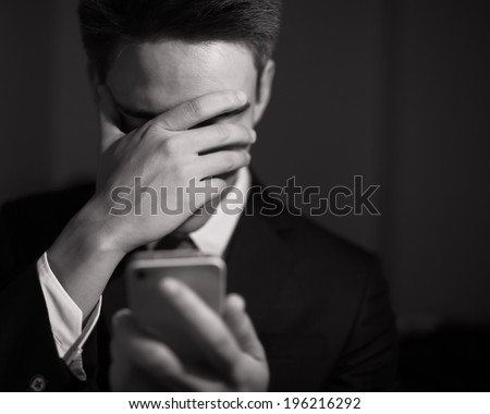 Depressed business man. - stock photo