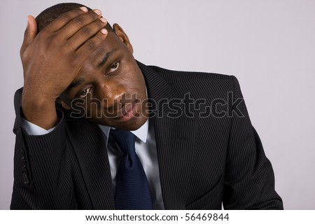 Depressed Business man having an headache - stock photo