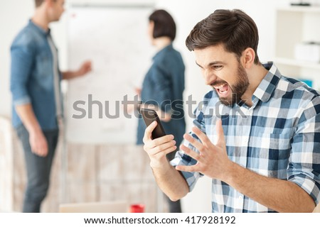 Depressed businessman is expressing negative emotions - stock photo