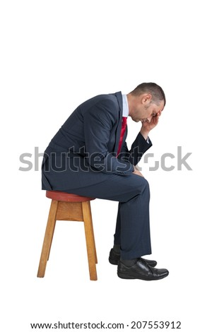depressed businessman seated isolated on white background - stock photo