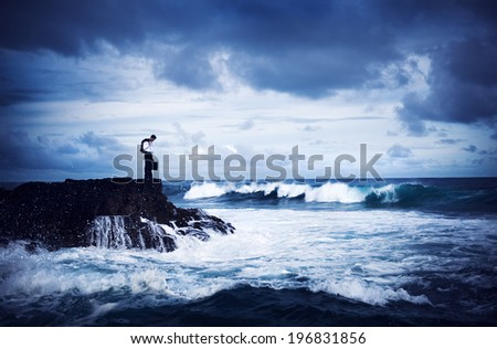 Depressed Businessman Standing by the Sea - stock photo
