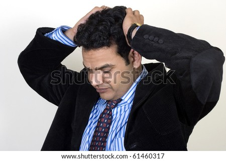 Depressed Businessman with his hand on his head - stock photo