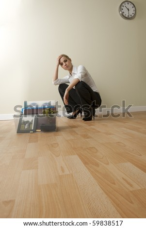 Depressed businesswoman losing her job due to corporate downsizing