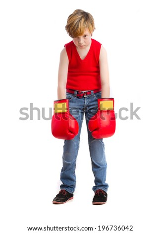 Depressed child with a boxing gloves - stock photo