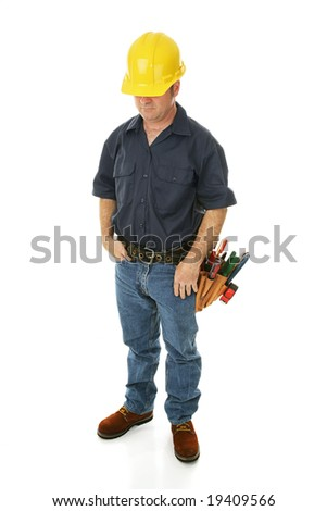Depressed, downcast construction worker wondering about his employment prospects.  Isolated.