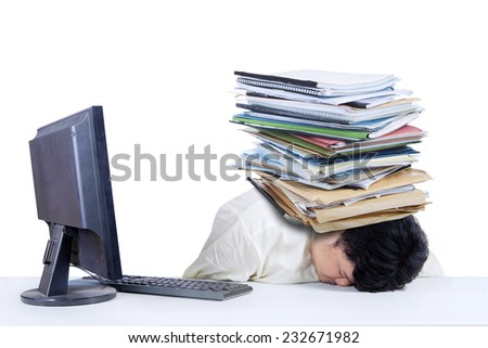 Depressed fat businessman with a pile of documents on his head at office - stock photo